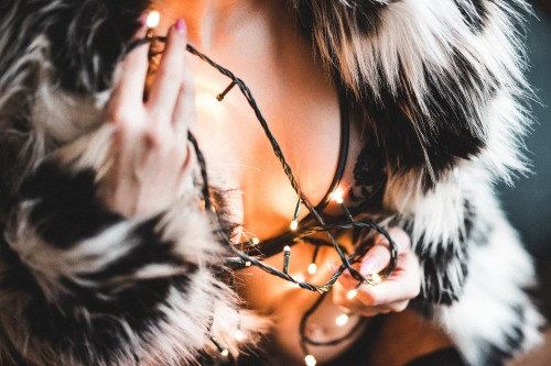 woman-in-a-luxury-fur-coat-with-christmas-lights.jpg