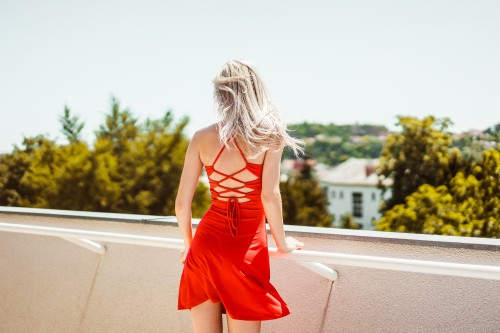 young-blonde-woman-looking-around-on-terrace.jpg