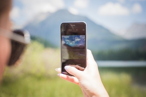 girl-taking-a-photo-of-mountains_free_stock_photos_picjumbo_HNCK7449.jpg