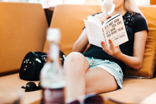 woman-reading-a-book-in-a-cafe.jpg